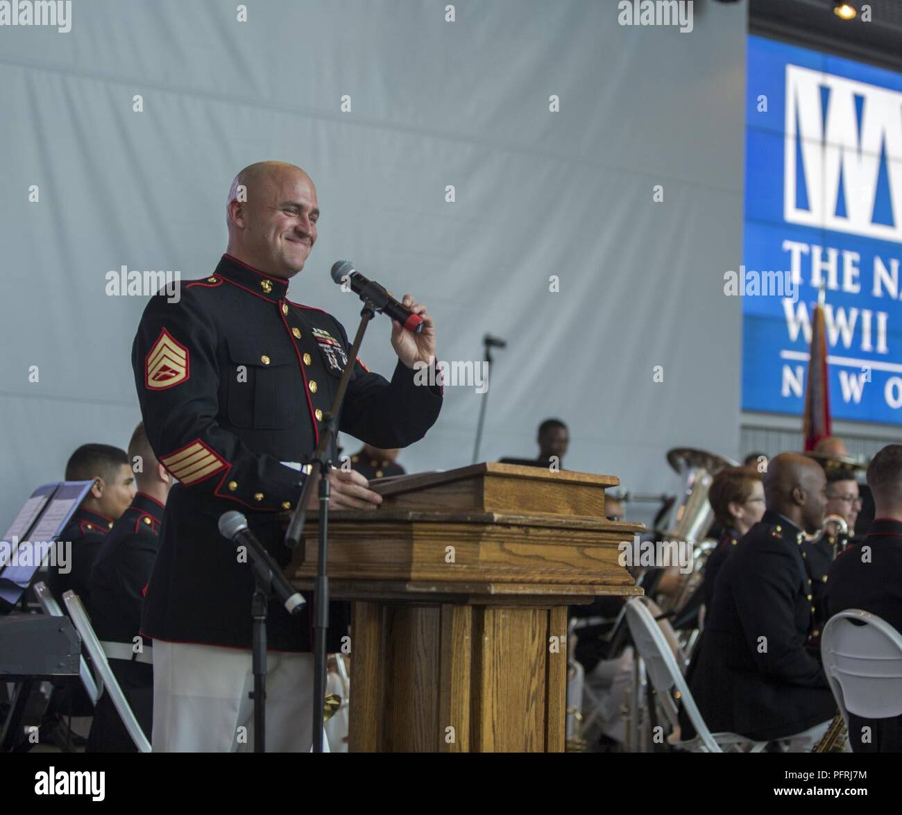 Staff Sgt. Keith Algeo, drum major with The Marine Forces Reserve Band, introduces the next performance during a Memorial Day Remembrance ceremony at the World War II Museum in New Orleans, May 26, 2018. The Marines performed to the public to honor the men and women who have given the ultimate sacrifice for their nation. - Stock Image