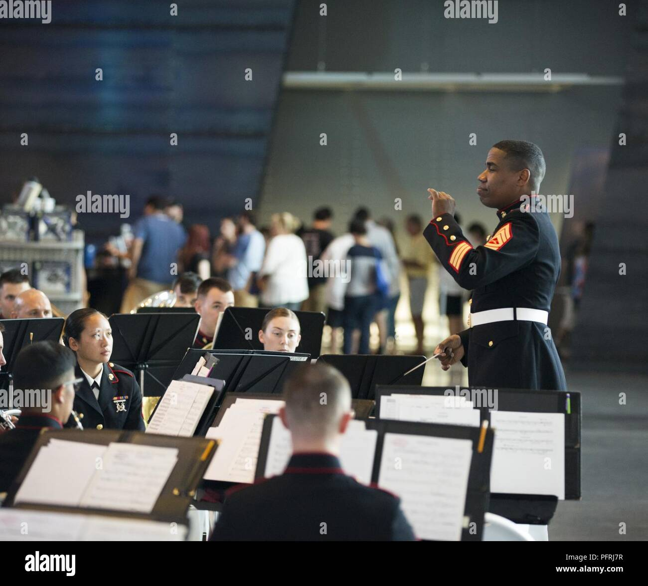 Gunnery Sgt. Justin A. Hauser, band master with The Marine Forces Reserve Band, conducts the band during a Memorial Day Remembrance ceremony at the World War II Museum in New Orleans, May 26, 2018. The Marines performed to the public to honor the men and women who have given the ultimate sacrifice for their nation. - Stock Image