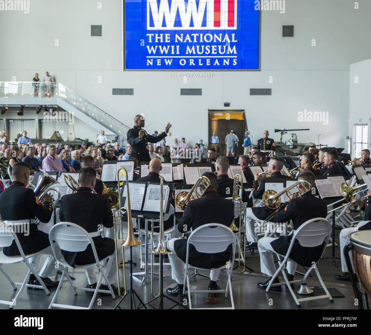 Chief Warrant Officer 2 DeMarius Jackson, officer in charge of Marine Forces Reserve Band, conducts the band during a Memorial Day Remembrance ceremony at the World War II Museum in New Orleans, May 26, 2018. The Marines performed to the public to honor the men and women who have given the ultimate sacrifice for their nation. - Stock Image