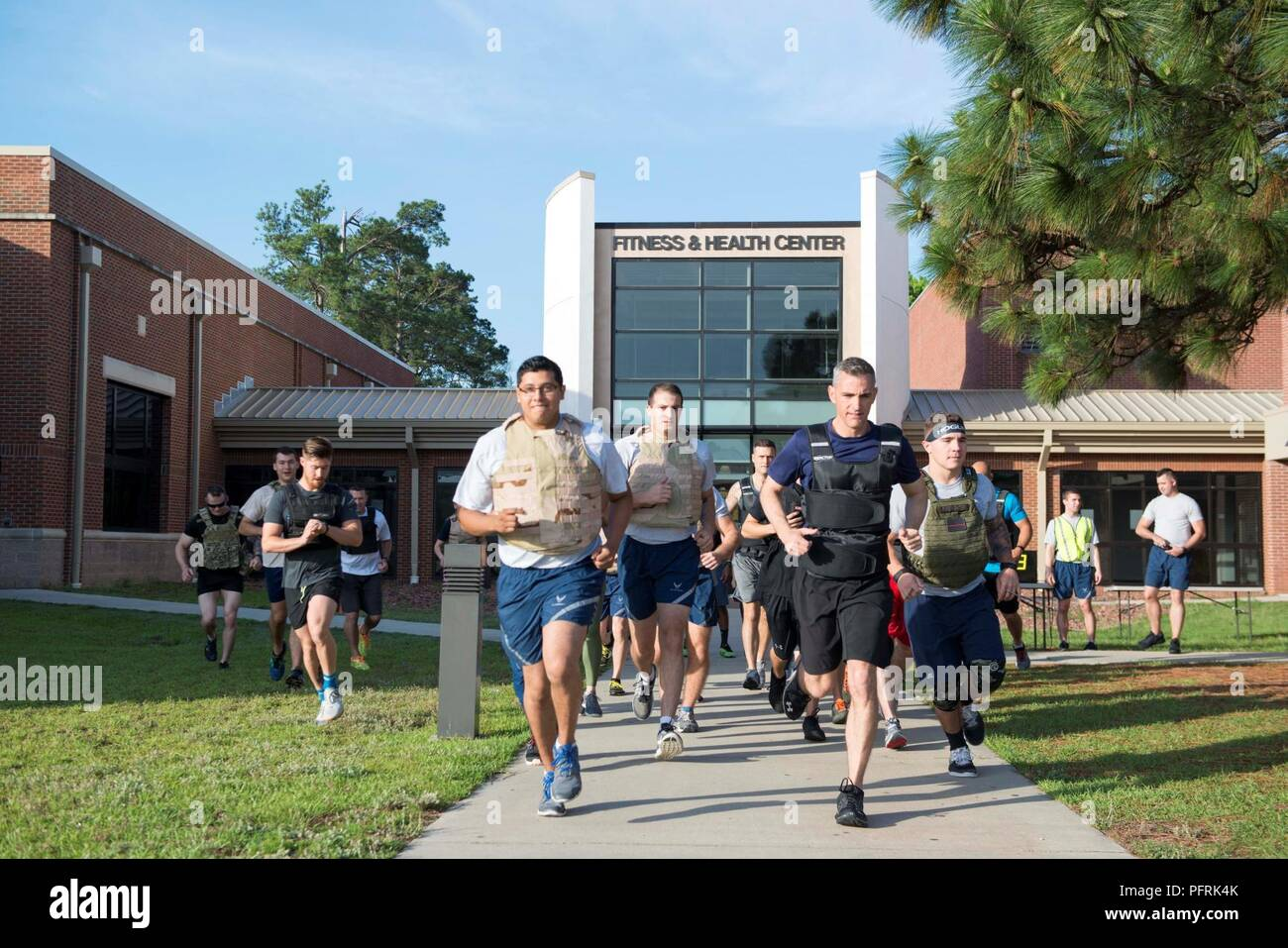 Team Shaw members begin the Murph Challenge at Shaw Air Force Base, S.C., May 24, 2018. The first segment of the workout was a mile run wearing a weighted vest. The purpose of the weighted vest is to simulate combat gear in a deployed environment. Stock Photo