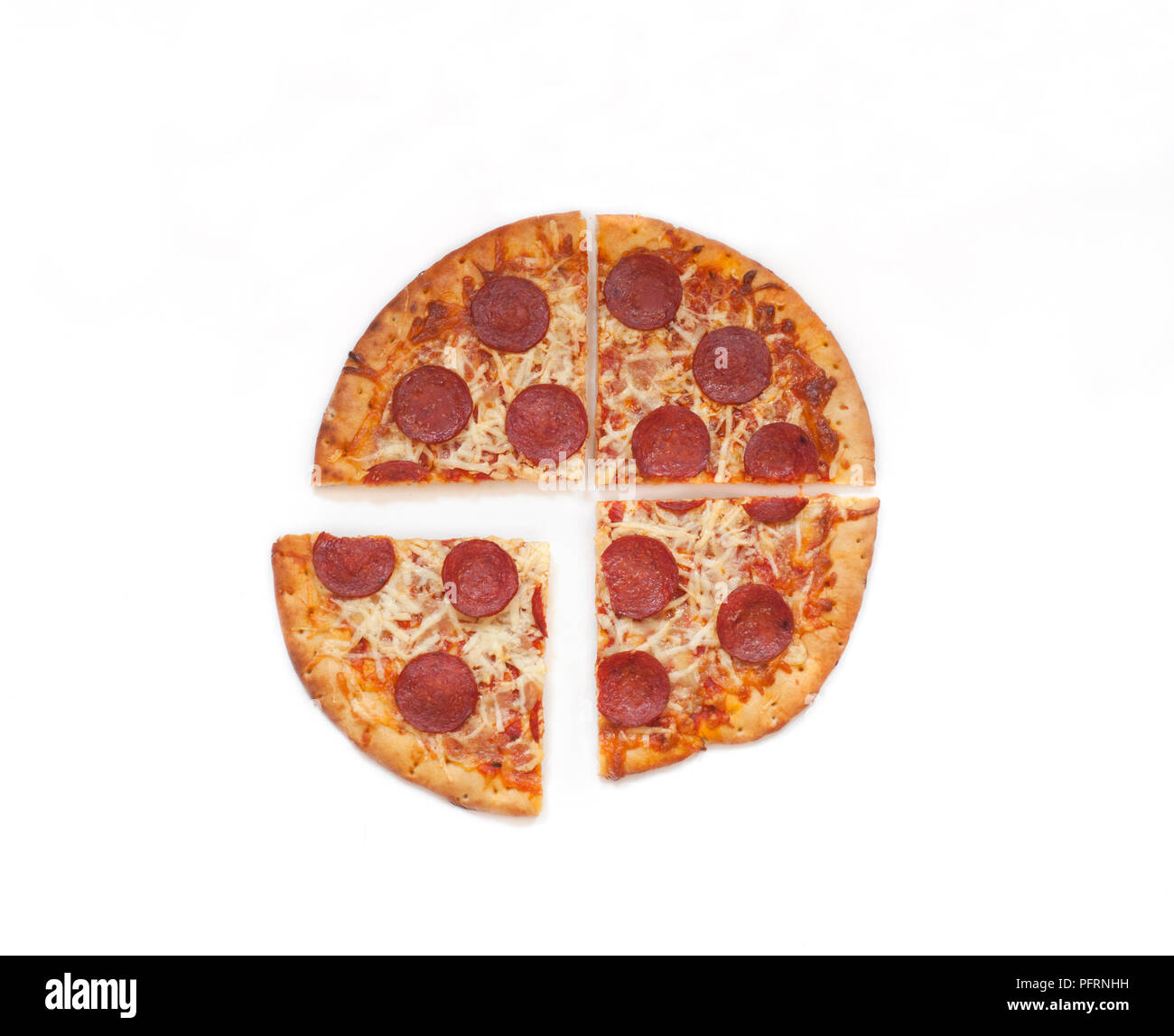 Pepperoni pizza cut into four quarters, one slice slightly removed from the others - Stock Image