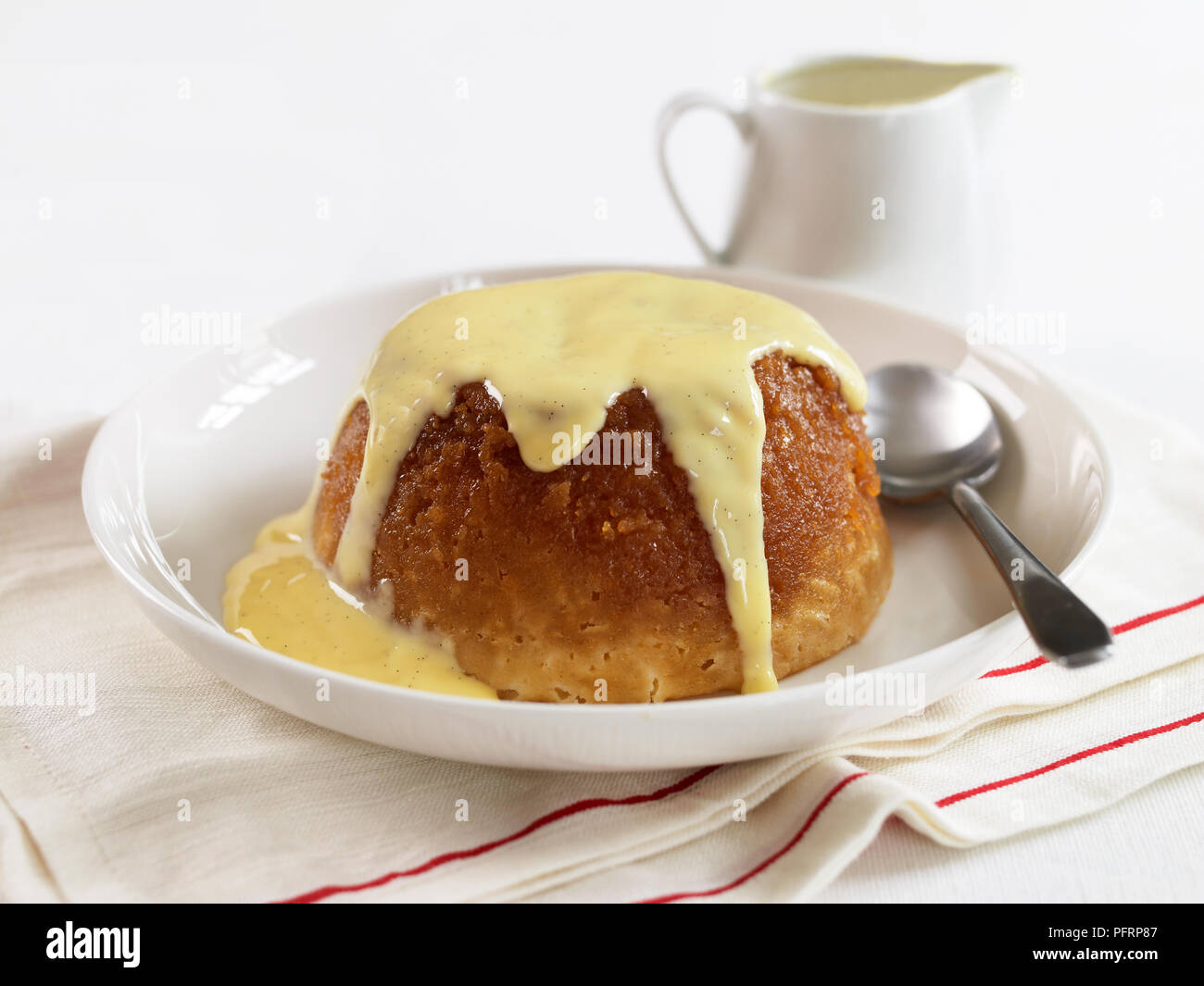 Treacle pudding with custard - Stock Image