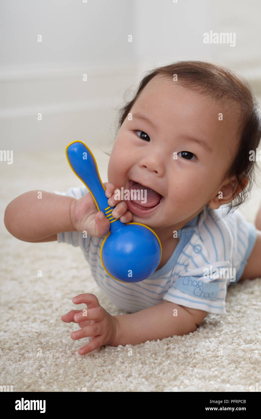 b63a37f35 Baby boy (6 months) holding plastic rattle Stock Photo: 216266747 ...