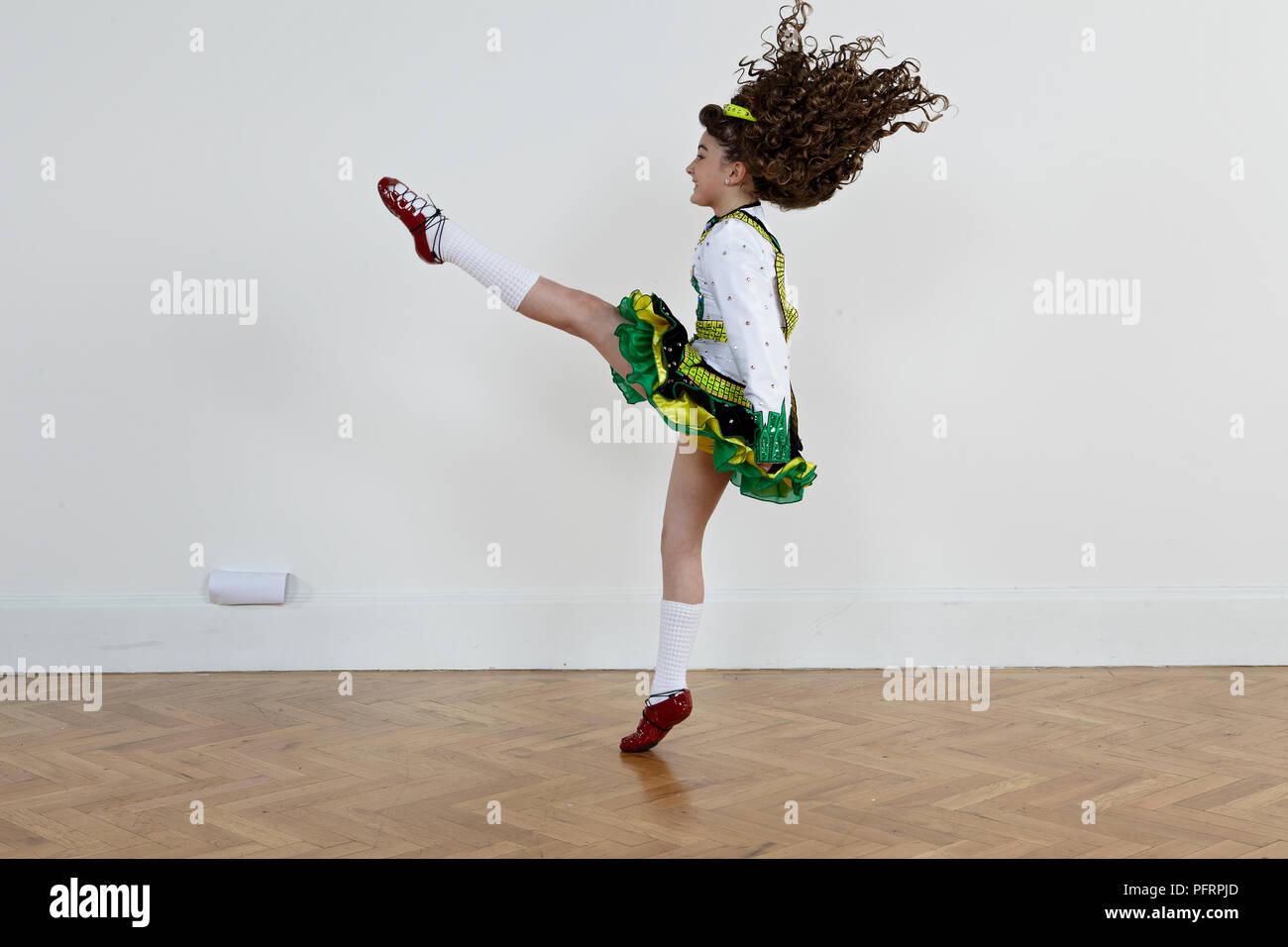 Hervorragend Girl Performing High Kick (Irish Dancing), Side View   Stock Image