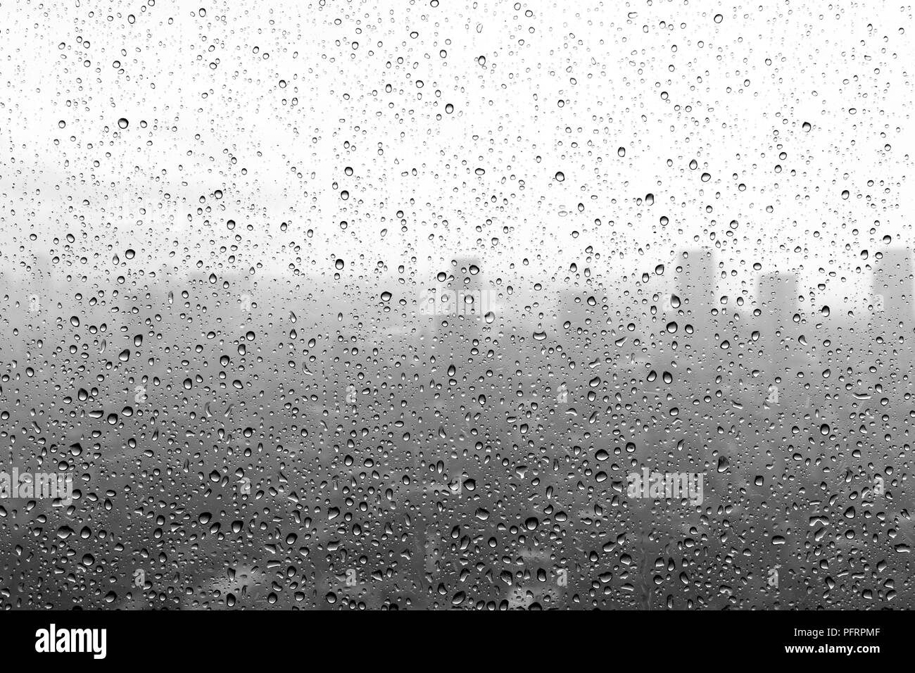 Black and white rain drops on a window stock photo 216266975 alamy