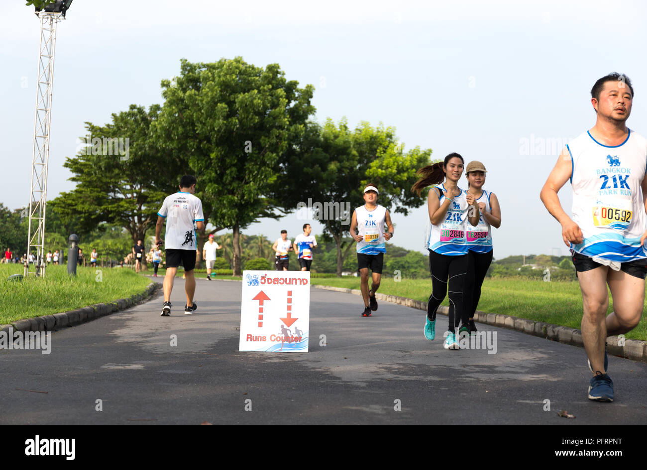 Bangkok Thailand - May 21, 2017 - Singha Logo on Marathon runners Group People Race Outdoor Sport Training in the park. - Stock Image