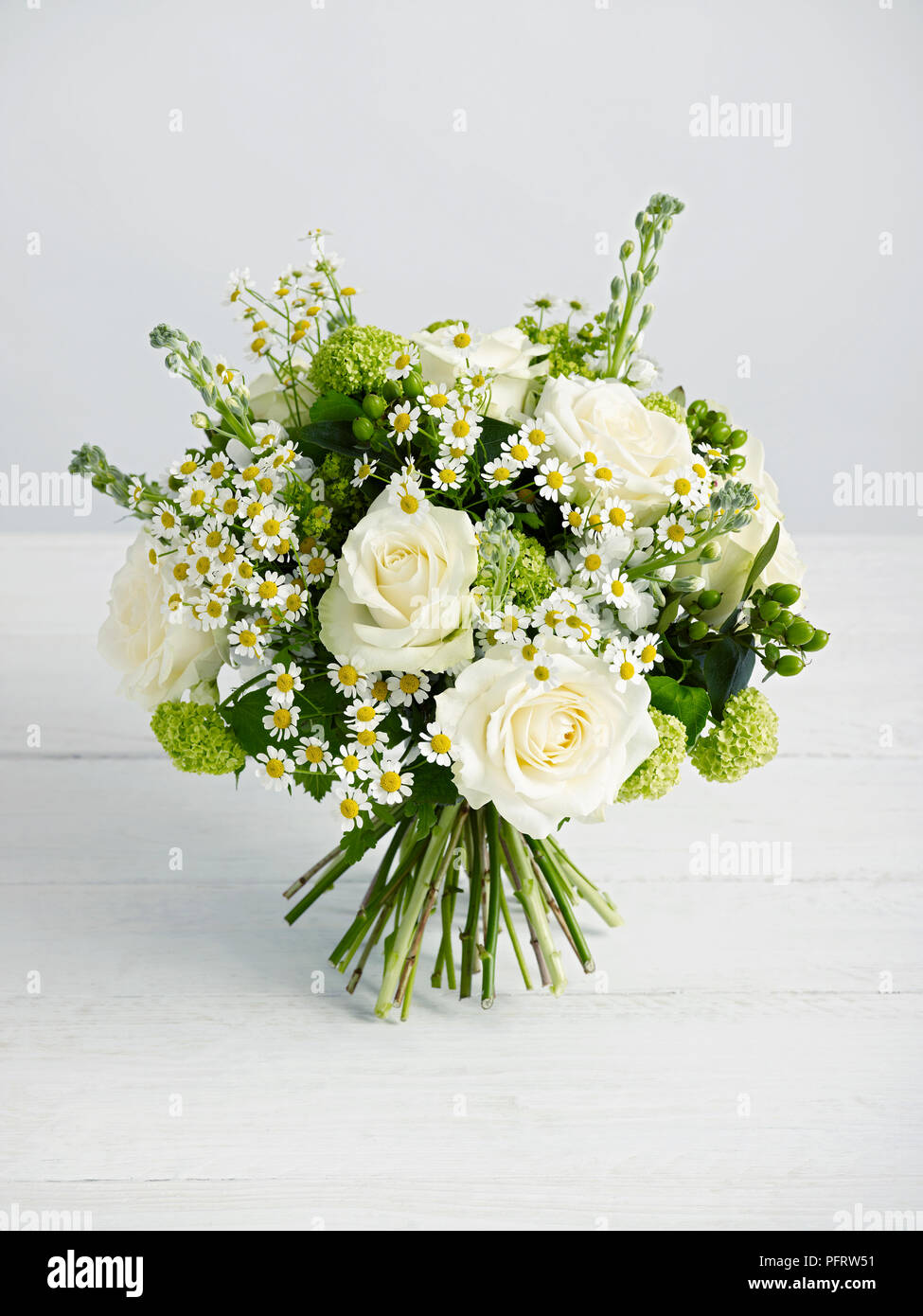 White And Green Hand Tie Bouquet Consisting Of Green Hypericum