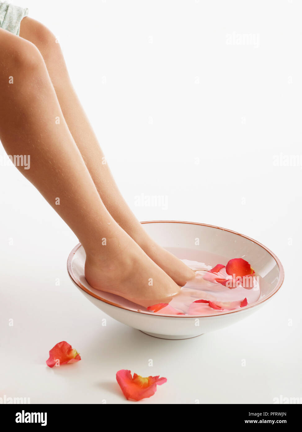 Feet in foot soak - Stock Image