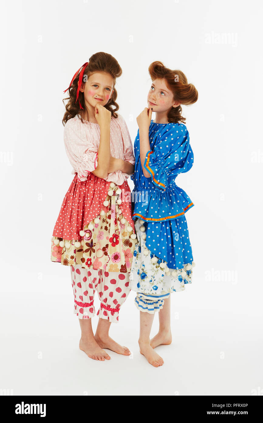 Two girls dressed as Cinderella's sisters in blue and pink fancy dress costume Stock Photo