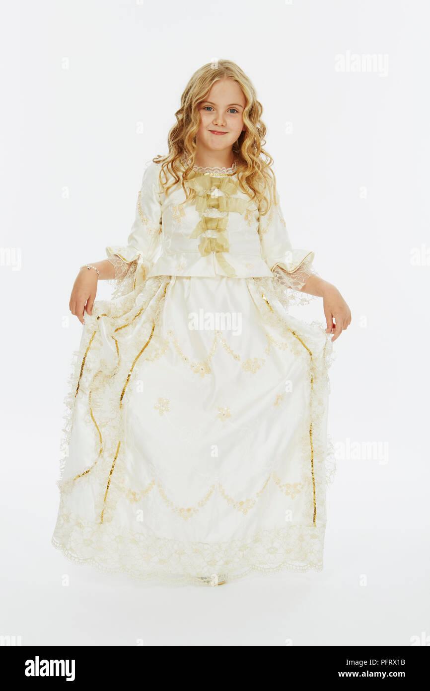 Girl wearing white satin ball gown Stock Photo: 216269575 - Alamy