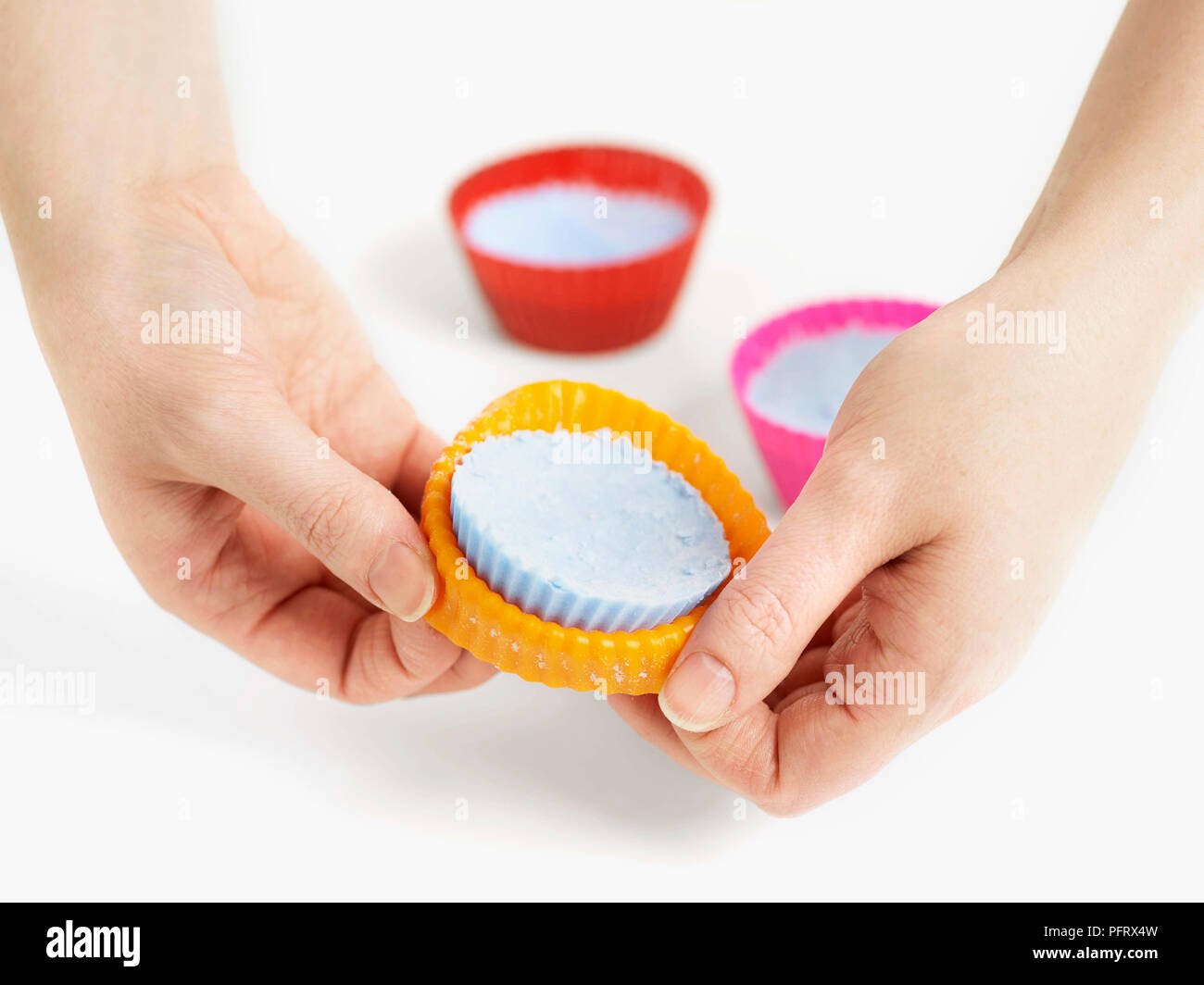 Step by step how to make bath bombs. Step 10, remove the bath bombs from the mould. - Stock Image