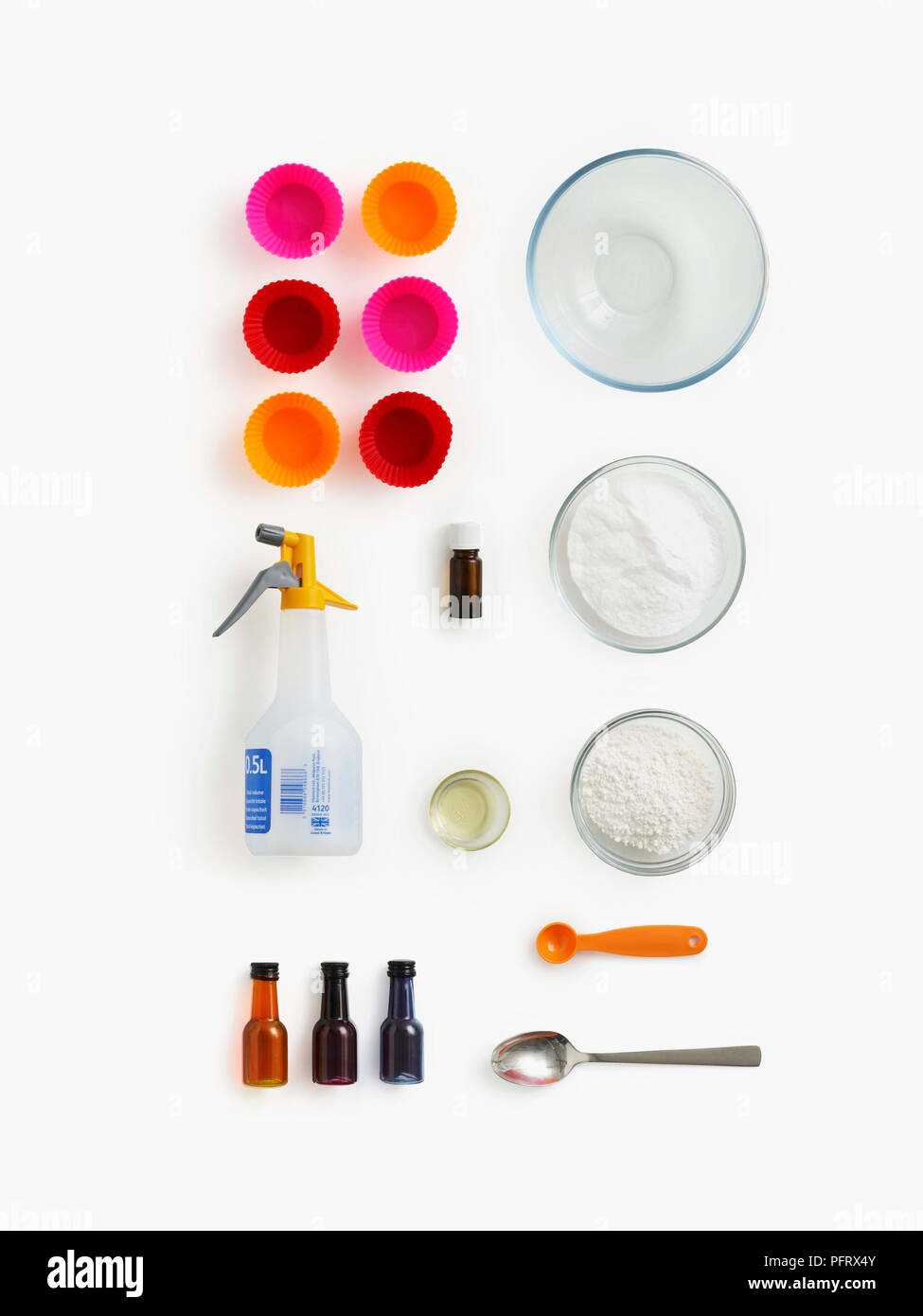 Materials needed to make bath bombs. Science experiemnt to do at home. The materials needed are cake moulds, a large bowl, essential oil, cream of tartare, water in a spray bottle, olive oil, bicarbonate of soda, teaspoon, fod colouring, and a tablespoon. - Stock Image