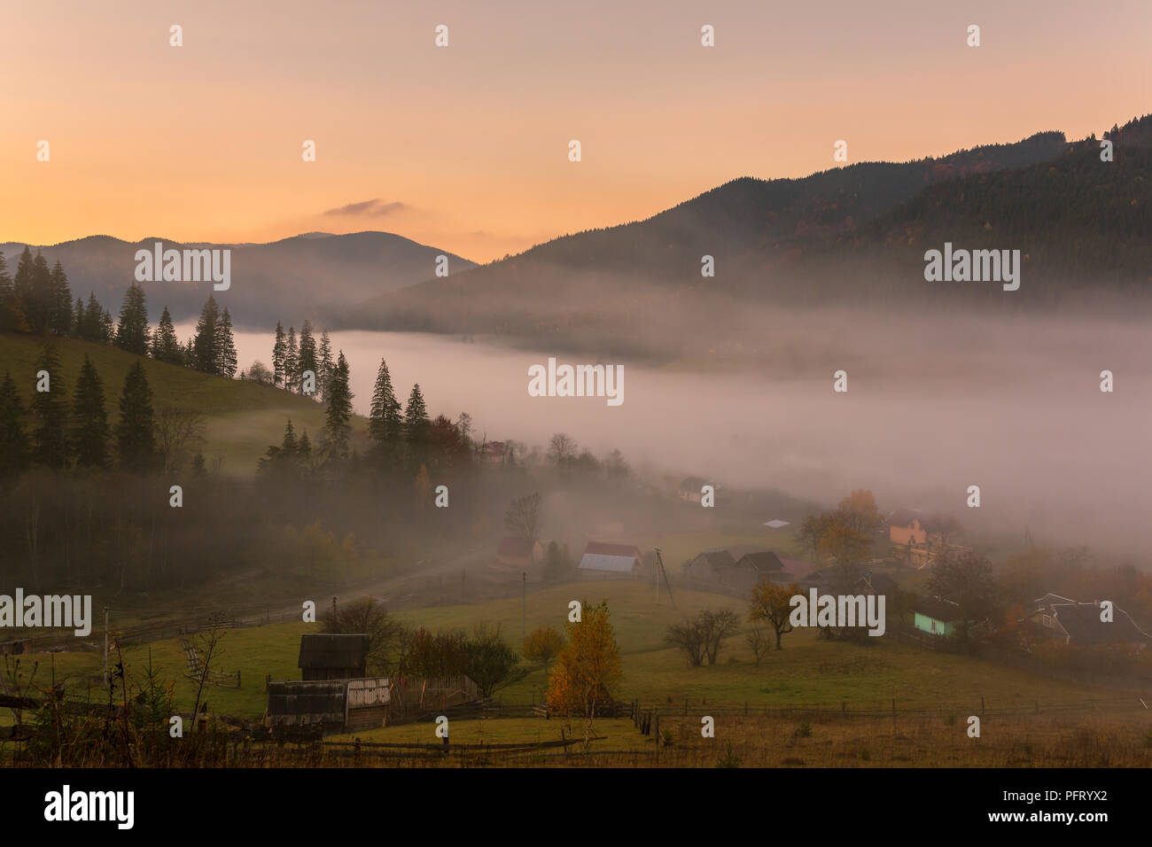 c9b36cbe7 Colorful autumn landscape in the mountain village. Foggy morning in the  Carpathian mountains, Ukraine