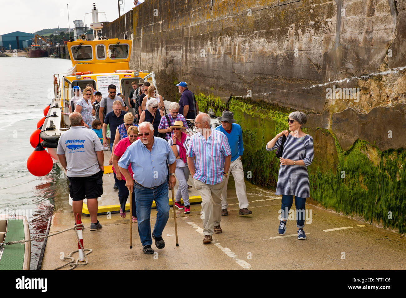 UK, Cornwall, Padstow, harbour, passengers disembarking Camel River Ferry from Rock Stock Photo