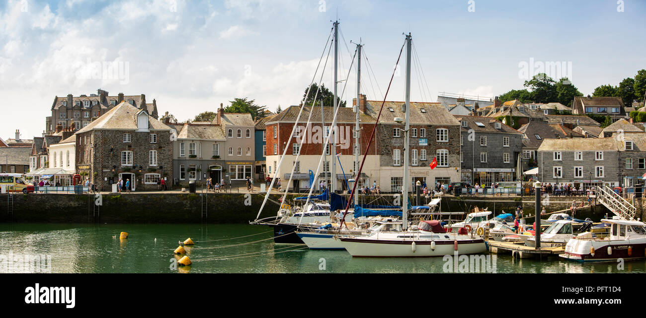 UK, Cornwall, Padstow, boats moored in inner harbour in front of South Quay, panoramic - Stock Image