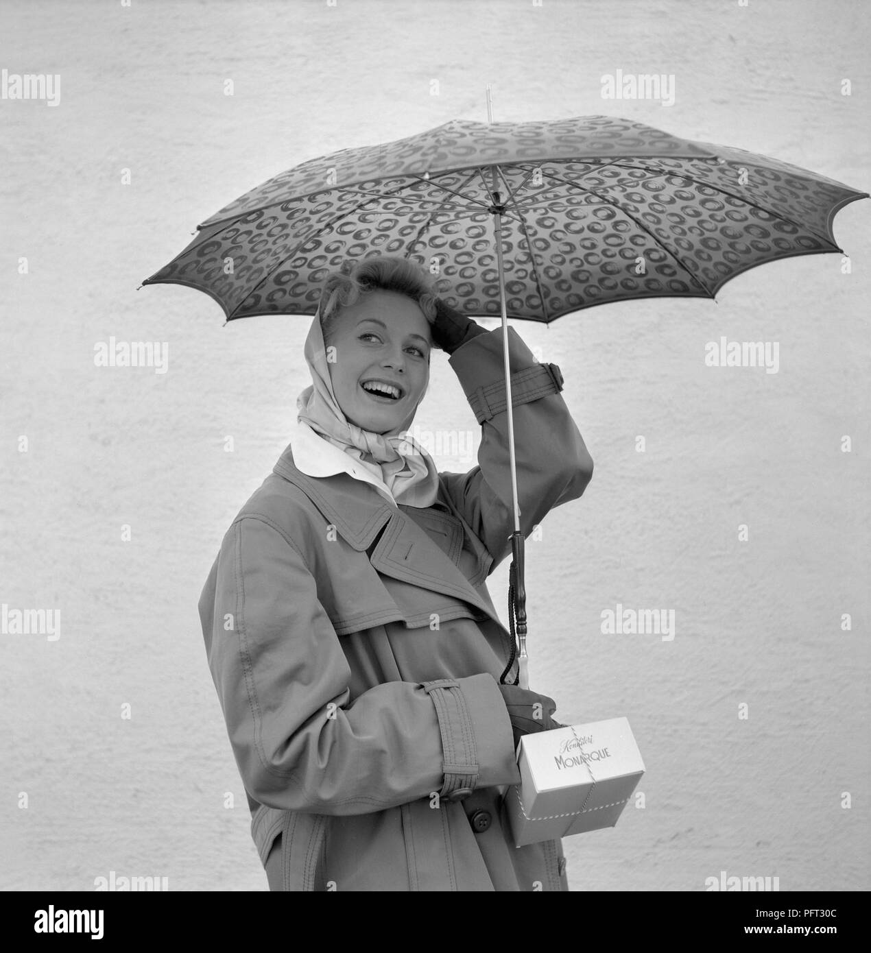 1950s Woman With Umbrella A Young Woman Is Holding An Umbrella On A