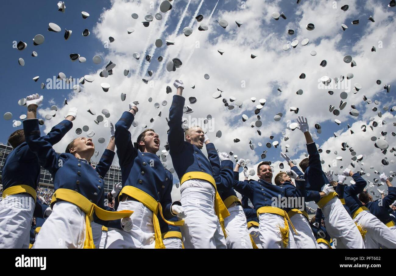 Graduates from the Air Force Academy toss their hats in the air at the conclusion of their commencement ceremony in Colorado Springs, Colorado, May 23, 2018. Stock Photo