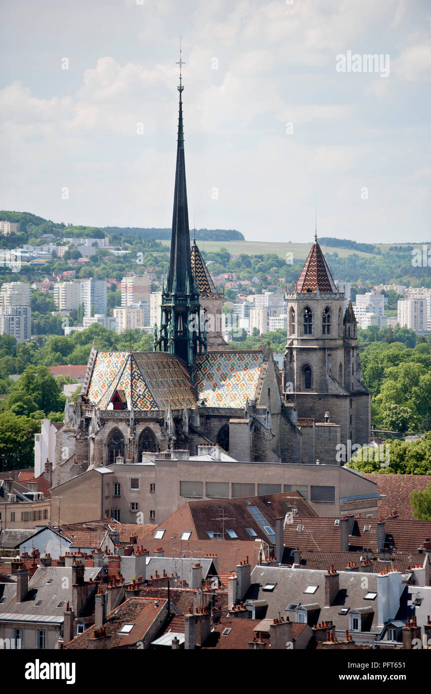 France, Dijon, Cathedrale Saint-Benigne de Dijon (Dijon Cathedral) with toits Bourguignons roof, tall spire, and twin towers Stock Photo