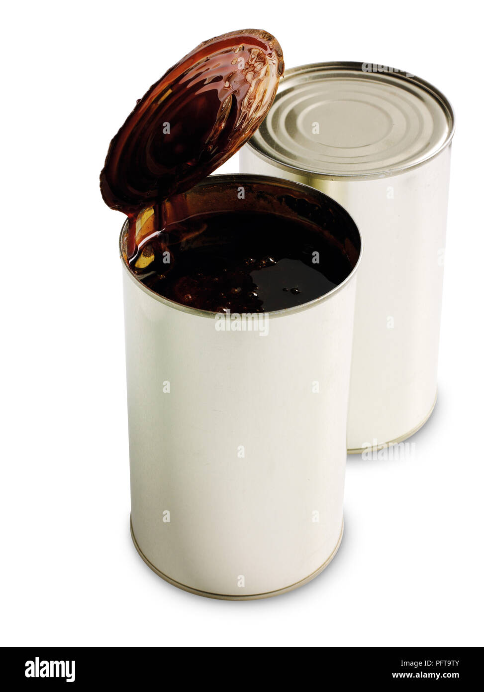 Tins of liquid malt extract for brewing beer - Stock Image