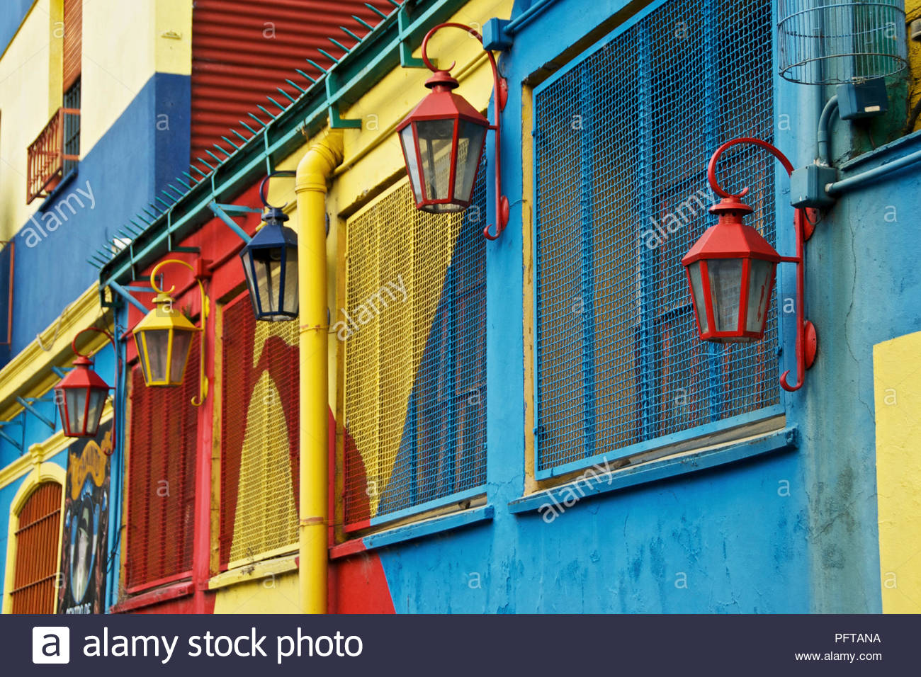 South America, colourfully painted building with street lamps, La Boca district, Buenos Aires, Argentina - Stock Image