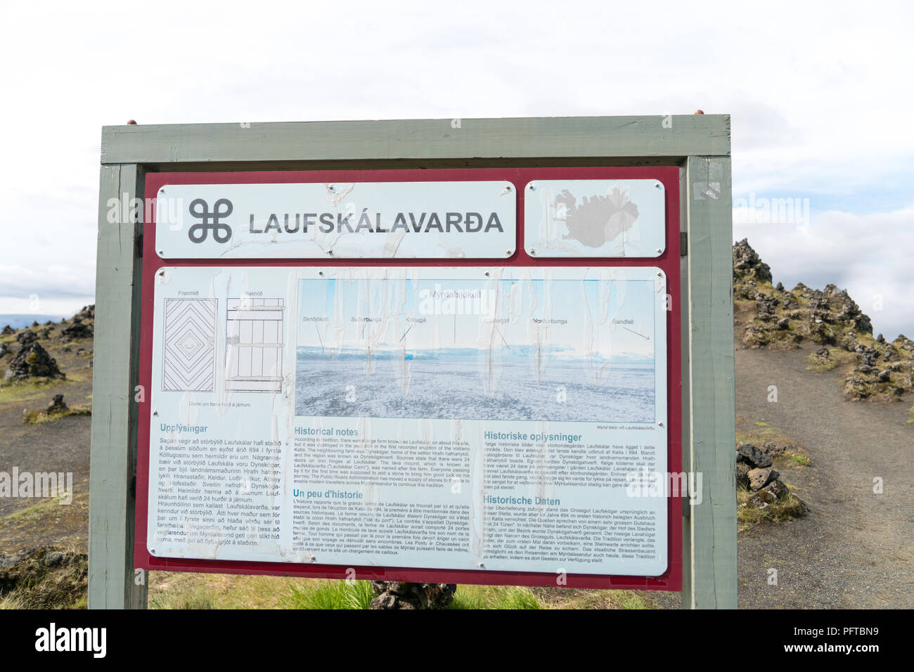 The tourist sign at Laufskalavarda, Iceland, explaining the tradition of leaving stone cairns to ensure good fortune on a traveller's journey. - Stock Image
