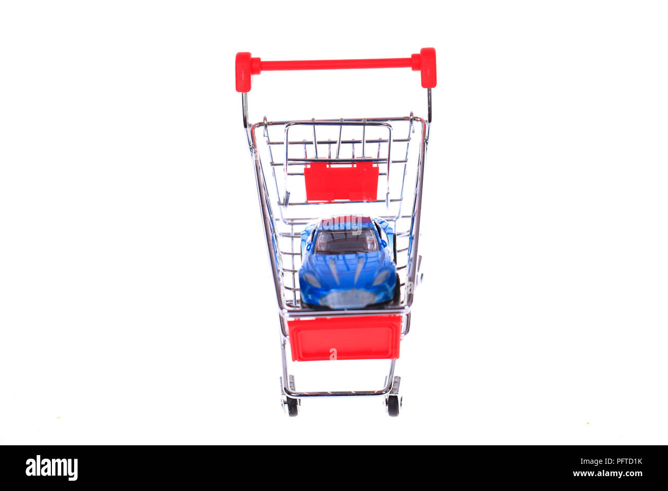 Car shopping, The car model in the shopping cart. - Stock Image