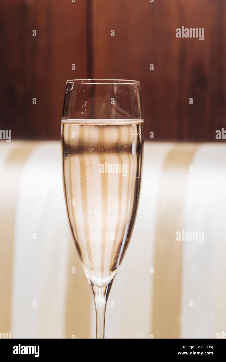 Prosecco glass in an elegant bar with vintage pop colors - Stock Image