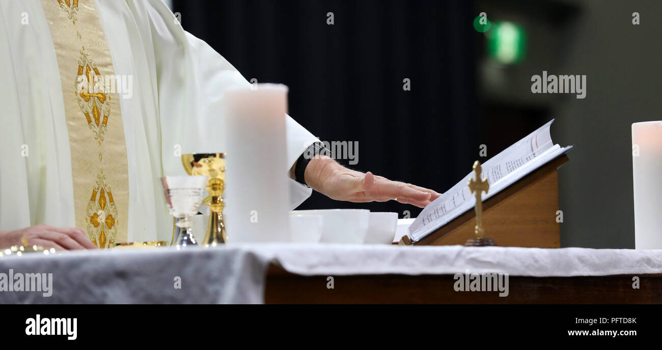 Catholic Priest Hands Serving Mass At A Liturgy Images Shows