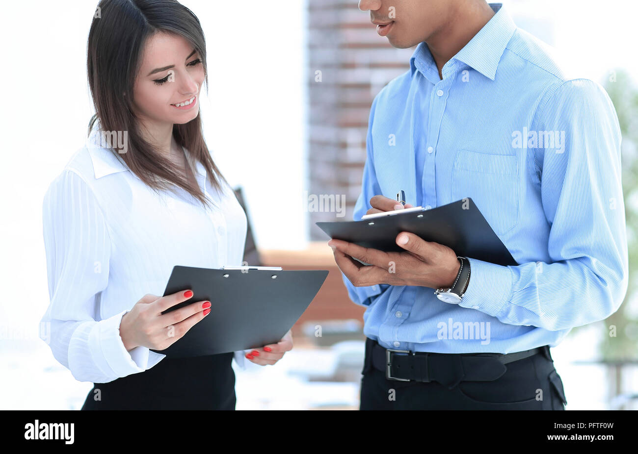 businessman and the employee discussing work schedule. - Stock Image