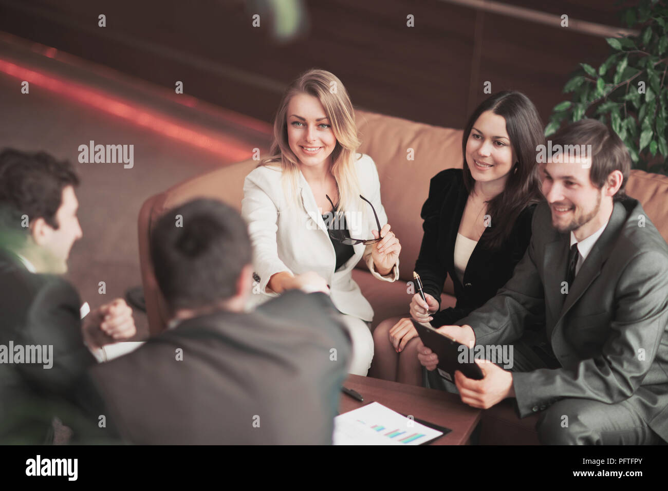 Conference of entrepreneurs. The conclusion of a very important contract by handshake - Stock Image