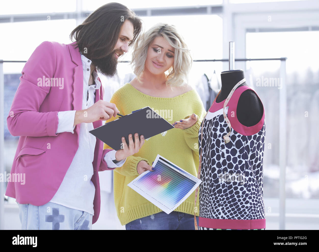 Two fashion designers discuss the color of the new clothing collection - Stock Image