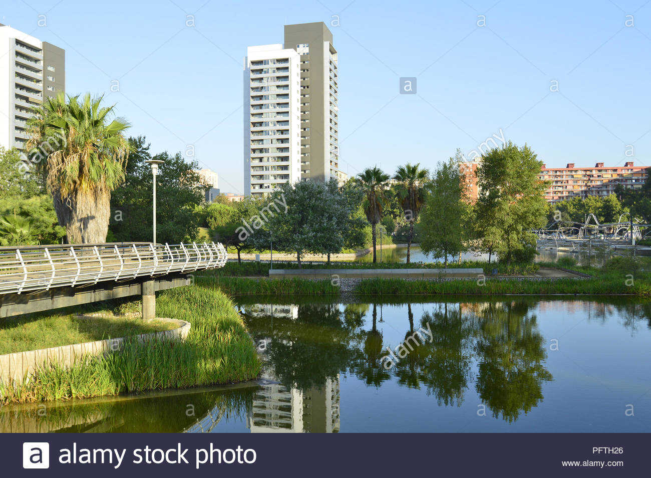 Parc Diagonal Mar - urban parkland with lakes and modern residential properties in Sant Marti district of Barcelona Spain. Stock Photo
