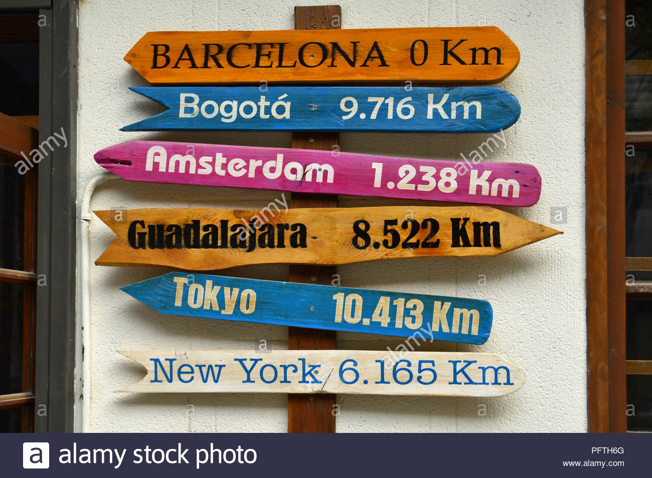 Cities destinations distance direction sign in Barcelona Spain Europe. - Stock Image