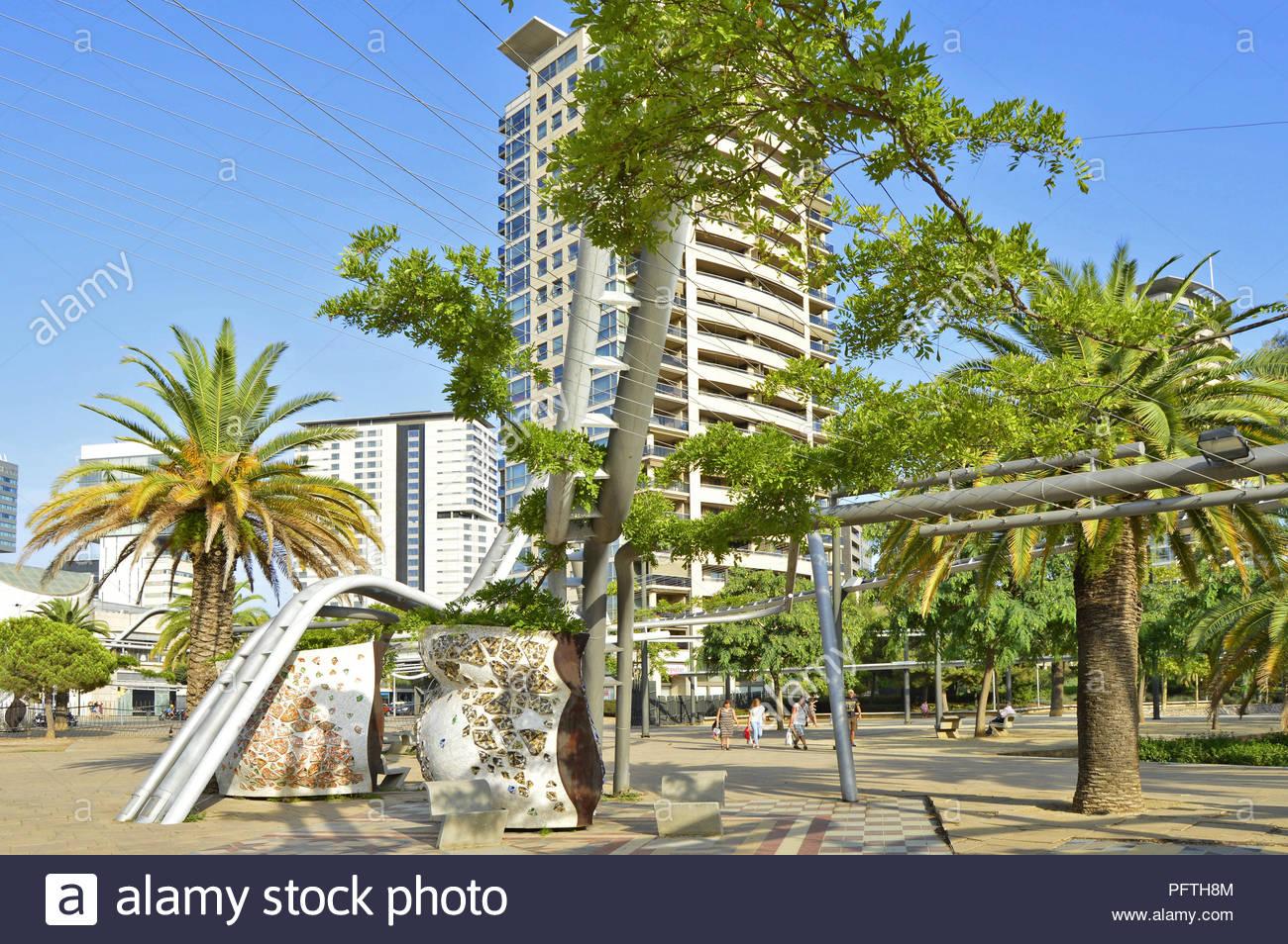 Parc Diagonal Mar - urban park lush greenery and hi-rise residential properties in Sant Marti district of Barcelona Spain Europe. Stock Photo