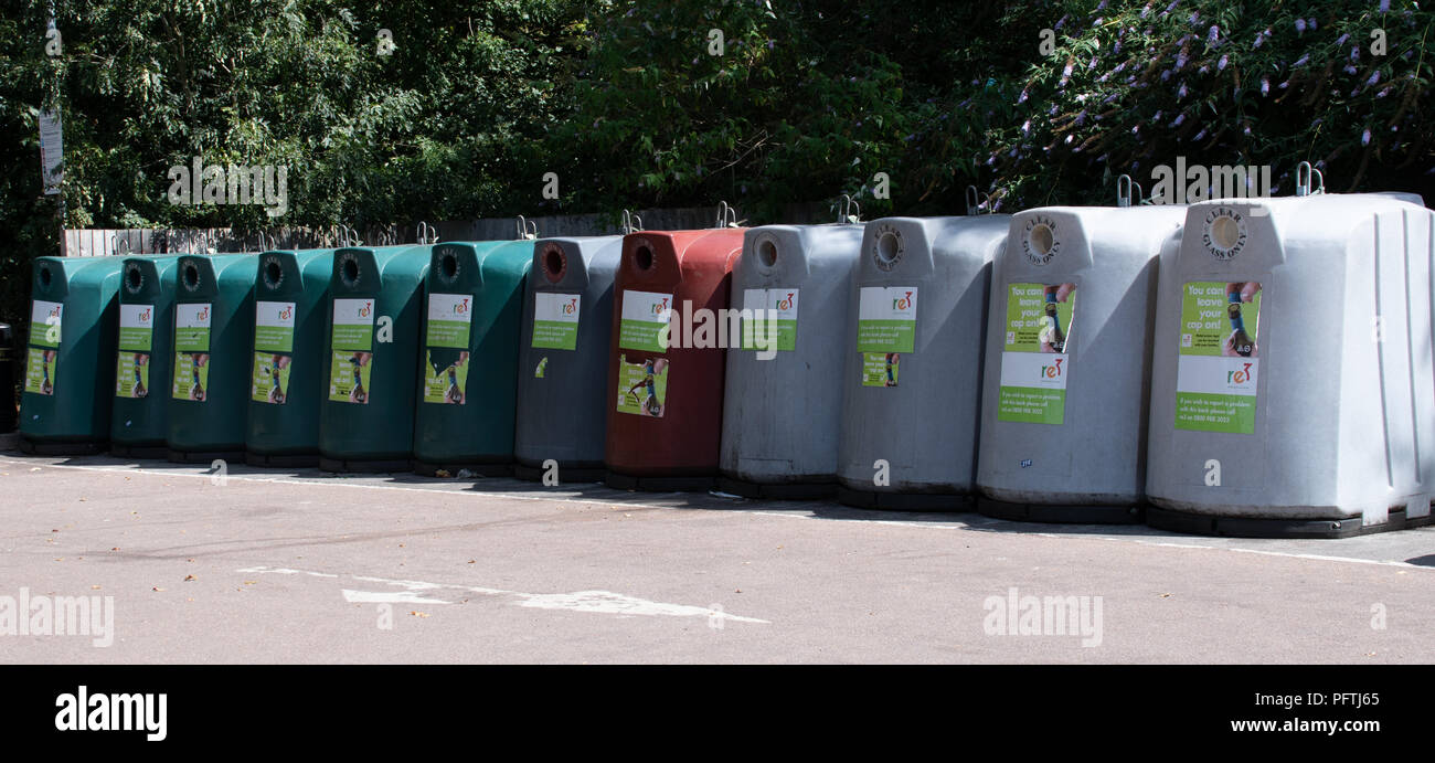 Reading, United Kingdom - August 06 2018:   A row of Bottle banks for recycling glass in Tesco's car park on Napier Road - Stock Image