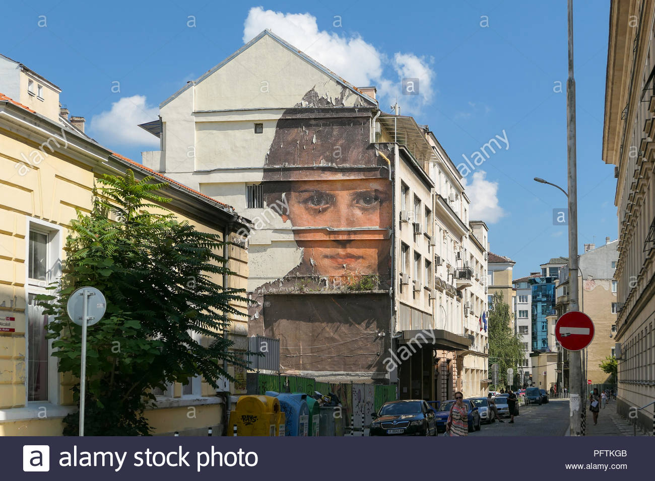 Sofia street - The Outings Project by Julien de Casablanca - painting of Portrait of a Child on building (original painting by Dechko Mandov) Bulgaria - Stock Image