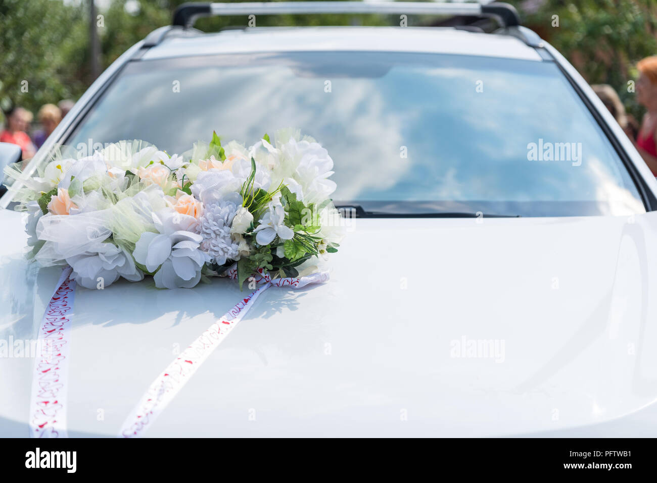 Car decorated on wedding day, decoration on car hood, organization of solemn events - Stock Image