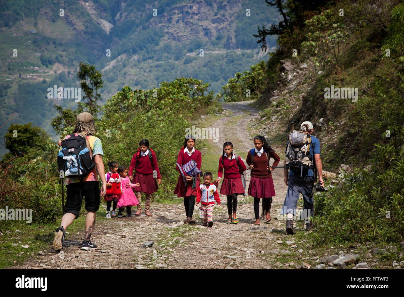 Children walking to school. Landruk. Annapurna trek. Nepal - Stock Image