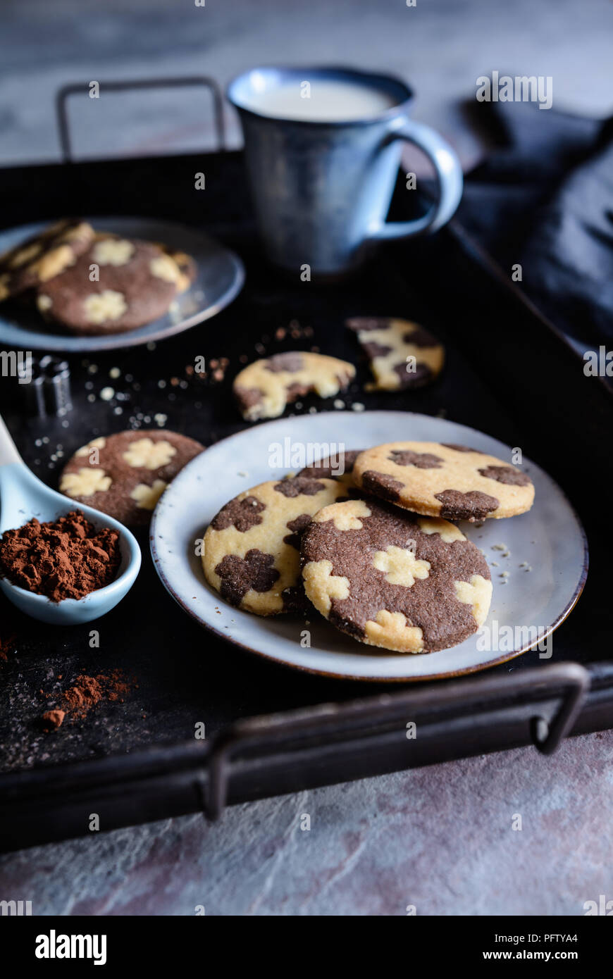 Cocoa and vanilla bicolor cookies with four leaf clover decoration Stock Photo