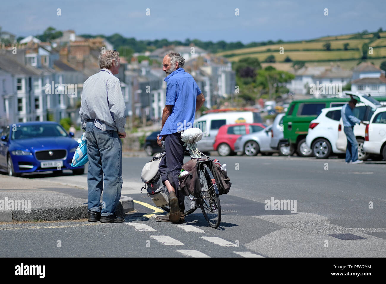 Two older men talking in Falmouth, Cornwall. - Stock Image