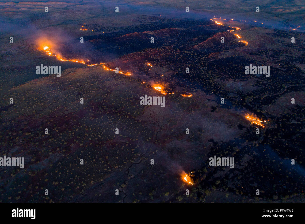 Bush fire seen from the air in Australian outback, Kimberley, Northwest Australia - Stock Image
