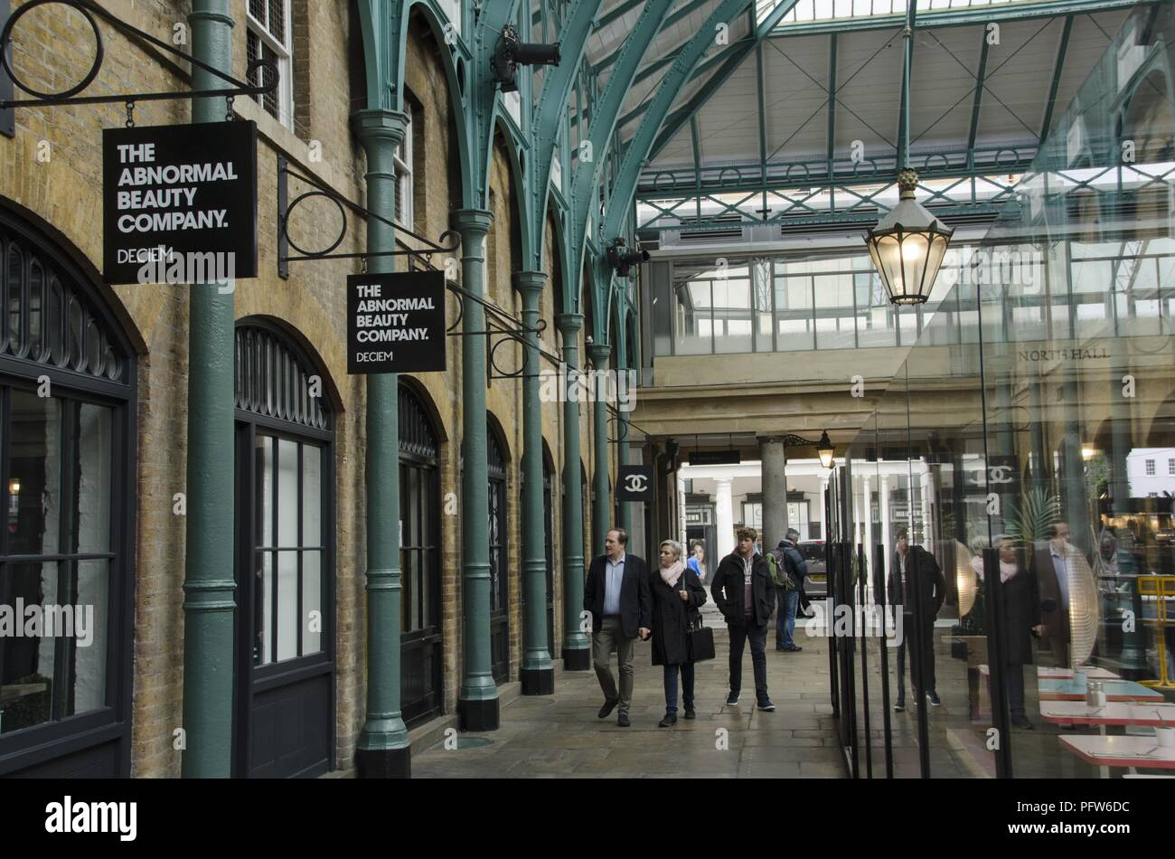 Passers in front of the 'Deciem' abnormal beauty company at the north hall of the New Covent Garden Market, Nine Elms, London, United Kingdom, October 29, 2017. () - Stock Image