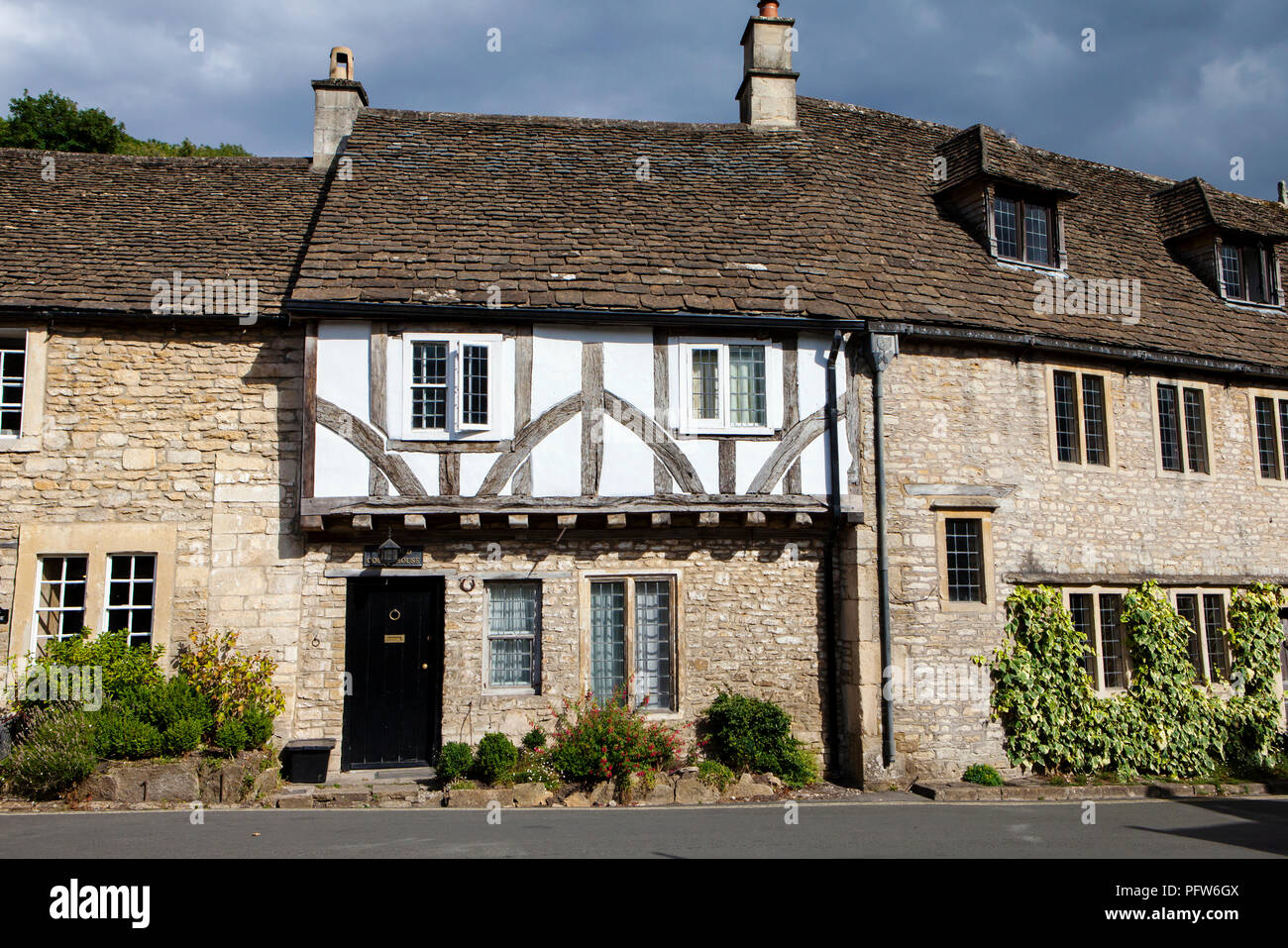 Castle Combe, UK - 9th August 2018: Castle Combe is a quintessentially English village often named as the 'prettiest village in England.' - Stock Image