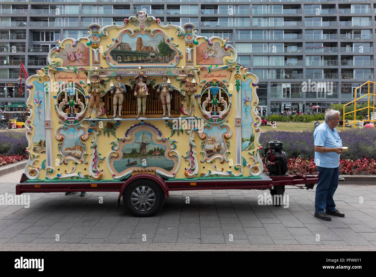 Rotterdam, Netherlands - July 7, 2018: Traditional Dutch street barrel organ named Rosalinda in summer in front of apartments - Stock Image