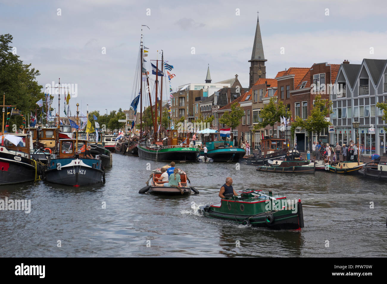 Leiden, Netherlands - July 28, 2018: Historical opduwers or opdrukkers, small tug- or towboats, on the canal during Sail Leiden 2018 - Stock Image