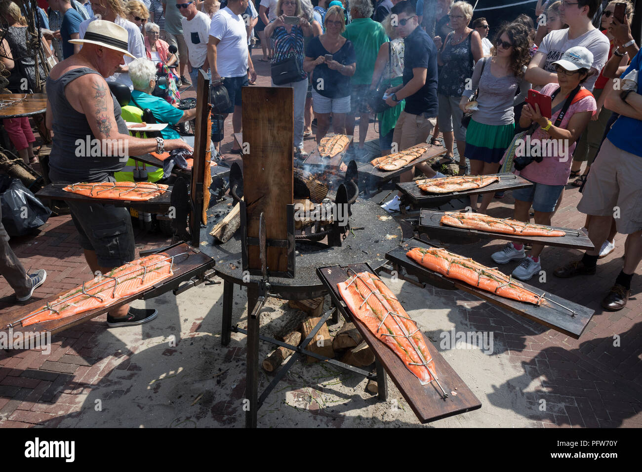 Leiden, Netherlands - July 28, 2018: Smoking fresh salmon during the festival of Sail Leiden 2018 - Stock Image