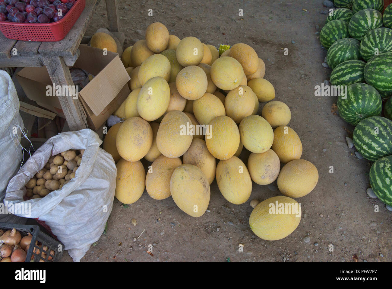 Melons for sale by the roadside, Osh, Kyrgyzstan - Stock Image