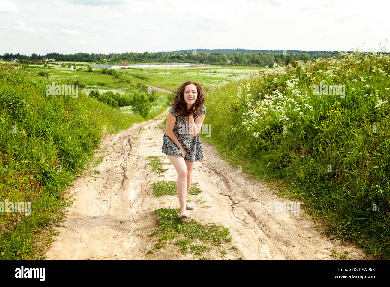 Beauty Girl Outdoors Enjoying Nature Beautiful Woman Jumping On Summer Field With Blooming Wild Flowers Sun Light Free Happy Woman Stock Photo Alamy