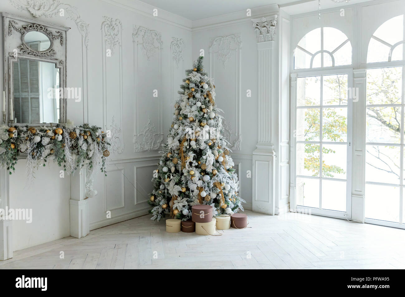 classic christmas and new year decorated interior room with presents and new year tree christmas tree with white and gold decorations