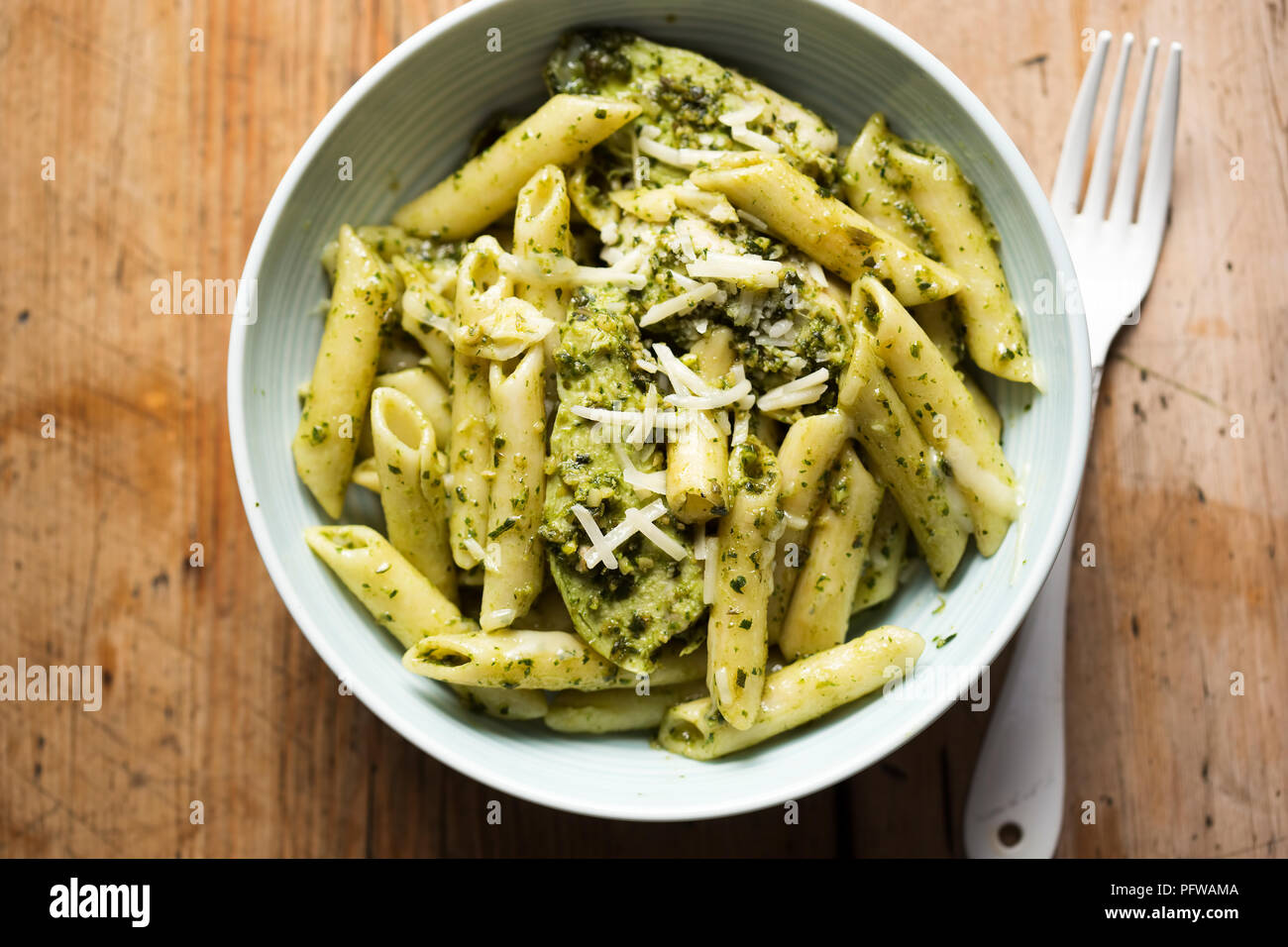 Green pesto chicken pasta with parmesan - Stock Image